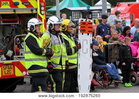 Beaulieu, Hampshire, Uk - May 29 2017: Firemen Waiting With Spineboard And Other Rescue Equipment Du