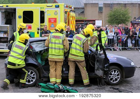 Beaulieu, Hampshire, Uk - May 29 2017: Firemen Preparing To Remove The Roof From A Car During A Vehi