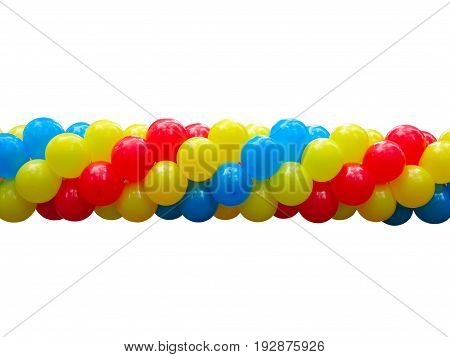 Red blue and yellow celebration balloons in stack isolated on white