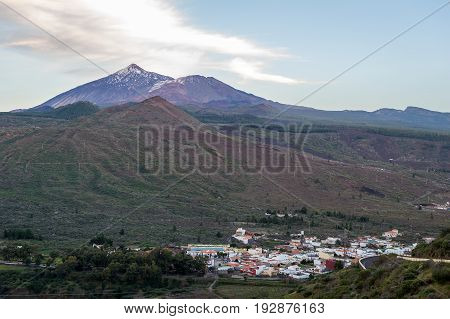 Evening view of Teide mountain and small town under the hills. Tenerife, Canary islands, Spain