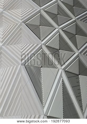 geometric white patterns and cladding on wall of a modern building