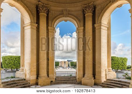 View through main basin monument arcs on Peyrou park with statue at Montpellier southern France