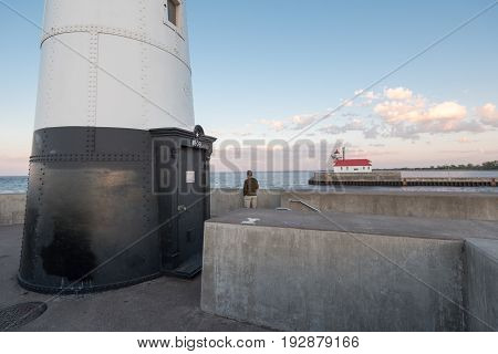 Lighthouses and Man in Canal Park in Duluth Minnesota
