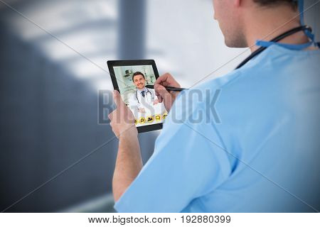 Surgeon using digital tablet against sterile bedroom