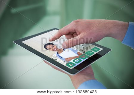 Croped hands of businessman using digital tablet against empty bed in the hospital room