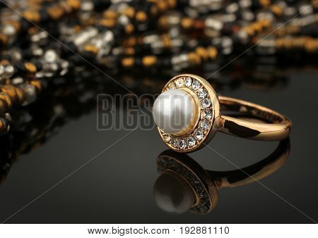 jewelry ring with pearl on black background