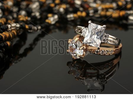 jewelry rings with diamonds on black background