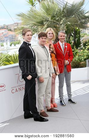 AJ Lewis, Alex Sharp, Elle Fanning and John Cameron Mitchell attend the 'How To Talk To Girls At Parties' Photocall during the 70th Cannes Film Festival at Palais on May 21, 2017 in Cannes, France.