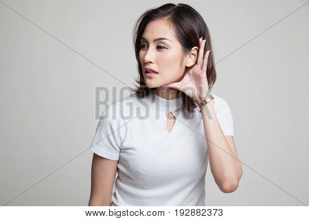 Beautiful Young Asian Woman Listen To Something.