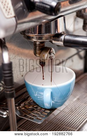 Pouring Fresh Coffee From The Machine In The Coffee Shop