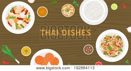 THAI dishes on wooden background, pork fried with sweet basil, jasmine rice, fish cakes, sour chilli beef salad in thai style, side dishes and chilli sauce, suitable for banner or poster
