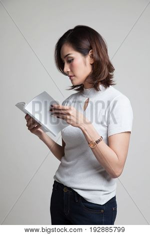Young Asian Woman Read A Book.