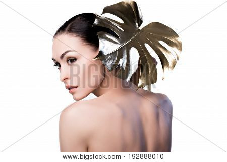 Back View Of Woman With Big Golden Leaf Looking Away Isolated On White