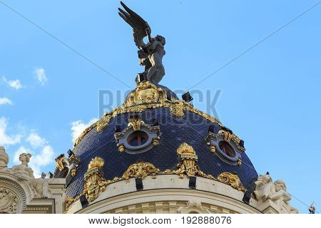 MADRID, SPAIN - MAY 24, 2017: This is dome of the Edificio Metropolis which is one of the symbols of the city.