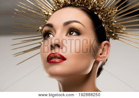 Glamorous Woman With Makeup Wearing Golden Headpiece Isolated On Grey