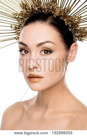 Portrait Of Gorgeous Woman In Golden Headpiece And Stylish Makeup Isolated On White