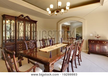 Bright dining room with cherry wood furniture