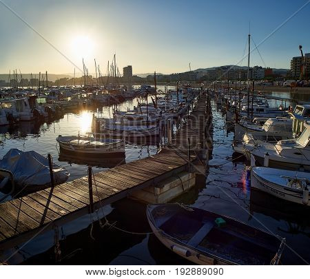 Palamos Spain - June 18 2017. Boats moored in the port of Palamos at sunset. Baix Emporda Girona Catalonia Spain.
