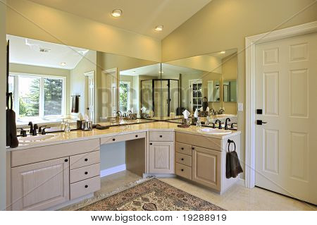 Angled view of bathroom with reflections in large mirrors