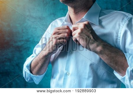 Businessman getting dressed for job interview man buttoning white shirt