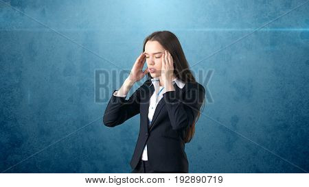 Young Attractive Longhair Businesswoman In Suit Stressed And Holding Her Head In Fatigue, Isolated S