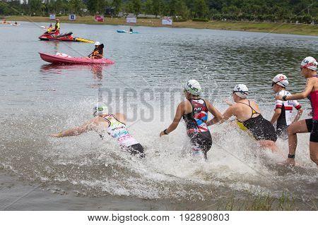 Nakhon nayokThailand - 25 June 2017: Group people in wetsuit swimming at triathlon in Challenge Nakhon Nayok 2017