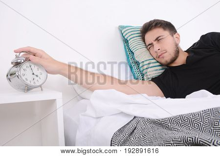 Man With Alarm Clock.