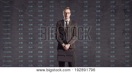 Businessman standing on a diagram background. Business, office, investment concept.