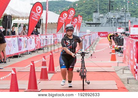 Nakhon nayokThailand - 25 June 2017: woman biker shove her bicycle from transition area to race in Challenge Nakhon Nayok 2017