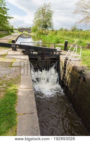 Canal lock gates at New Marton on the Shropshire Union canal in England UK used for raising narrowboats from upper or lower levels on the waterway