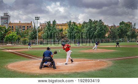 VALENCIA, SPAIN - JUNE 25: Unidentified people play baseball in the stadium at old Turia river burst in Valencia on June 25, 2017 in Spain