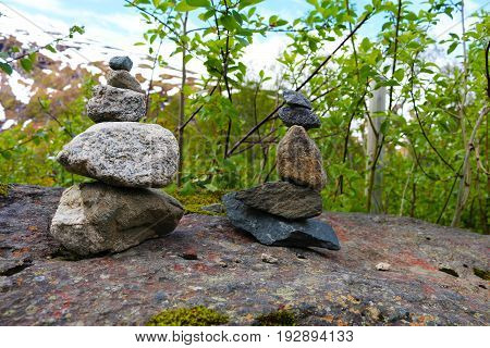 Cairn stones as markers on rock ledge