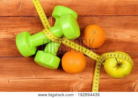 Sport Training Concept, Dumbbells Weight With Measuring Tape, Orange, Apple