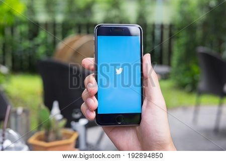 Chiang Mai, Thailand - June 16, 2017: Person Holding A Brand New Apple Iphone With Twitter Logo On T