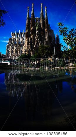 View and reflection of Sagrada Familia Basilica and Expiatory Church of the Holy Family - 09-03-2013 Barcelona Spain