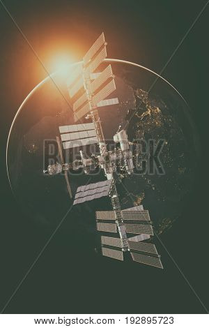 International Space Station Over The Planet Earth.
