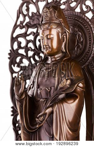 Bodhisattva sculpture Guan Yin with flower - the deity acting mainly in a female appearance saving people from disasters; giver of children patroness of female half of the house. It is known just as Avalokiteshvara bodhisattva.