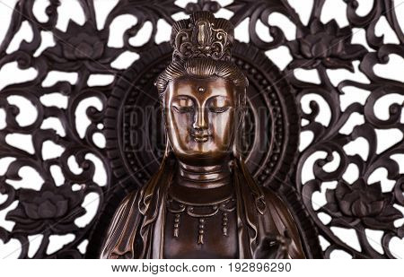 The face of Bodhisattva Guan Yin - the deity acting mainly in a female appearance saving people from disasters; giver of children patroness of female half of the house. It is known just as Avalokiteshvara bodhisattva.
