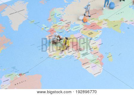 Figurine Of  Young Traveler Backpack Walking Big Map
