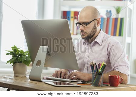 Business man working laptop businessman looking at camera one person