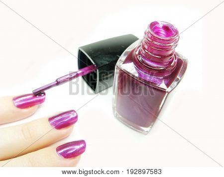 making manicure painting fingers with nail polisher
