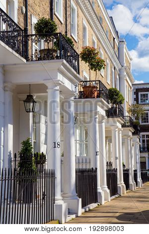 Row of beautiful white edwardian houses in Kensington London