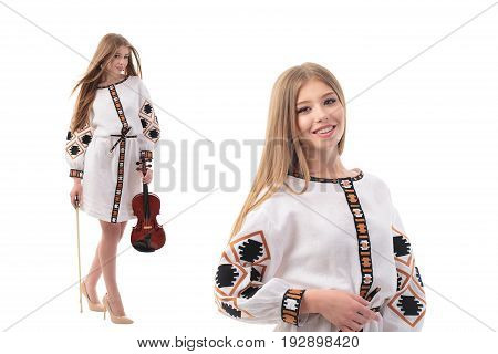 Beautiful Ukrainian woman in national costume. Attractive Ukrainian woman wearing in traditional Ukrainian embroidery, standing with violin over isolated white background. StudMiss Kyiv 2017 1-st place.