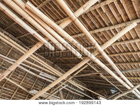 Thatch roof with the bamboo structure of the large pavilion in the Thai restaurant.