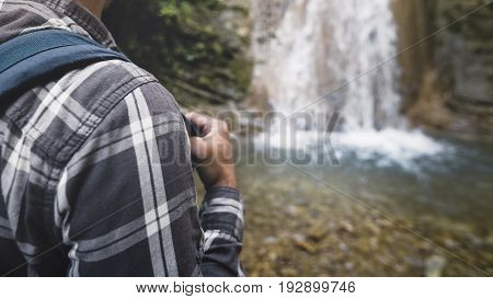 Backpack Strap For Traveling On Shoulder Of Tourist Waterfall Background Closeup Hiking Journey Travel Trek Concept