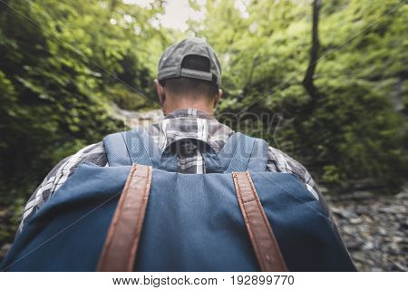 Man Tourist With Heavy Backpack Walking Through The Woods Wide Angle Rear View Hiking Journey Travel Trek Concept