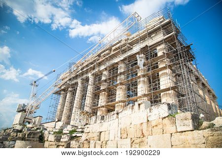 The Parthenon is under reconstruction. Ancient Greek temple Parthenon in Athens on a clear day against the blue sky