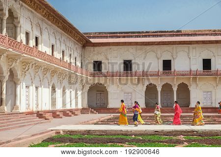 Agra India - April 30 2017 : Indian people walking by Khas Mahal and facing garden Agra Fort Agra India