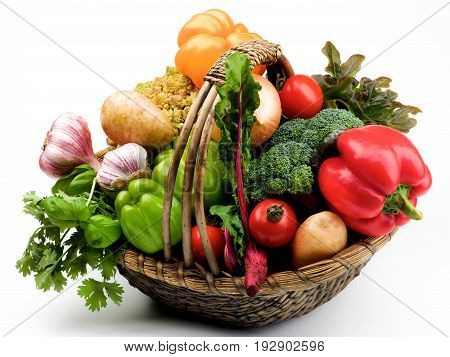 Fresh Vegetables Basket with Bell Peppers Greens Tomatoes Potatoes Garlic Onion Young Beet Broccoli and Romanesco Cauliflower closeup on White background