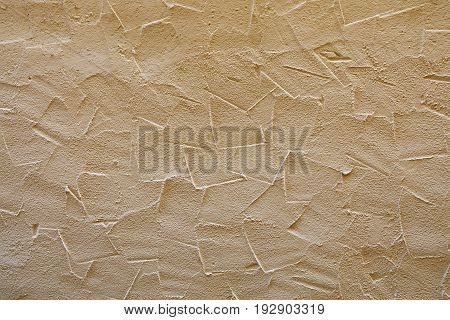 Beige Wall Of Embossed Decorative Plaster